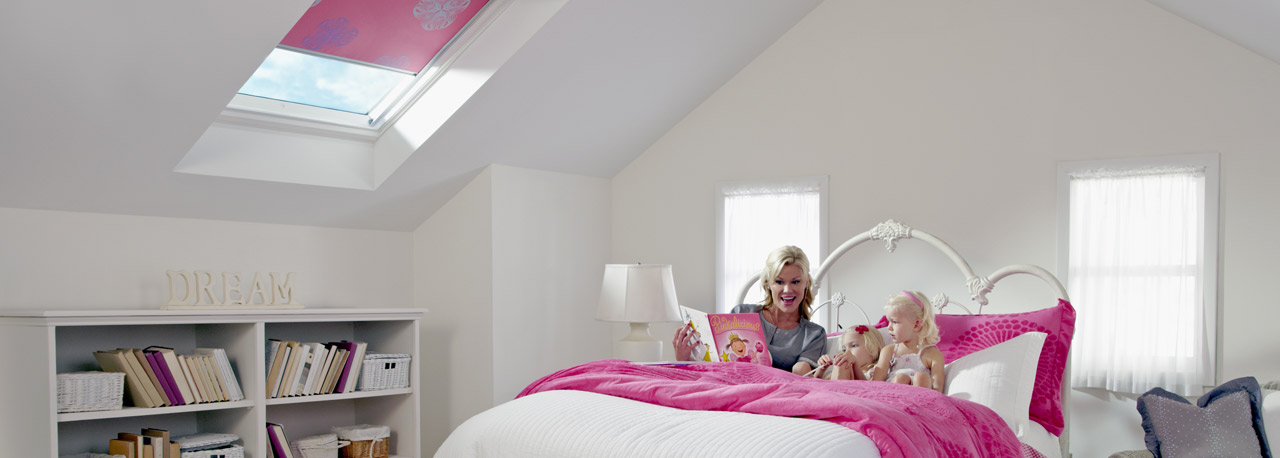 Pink blinds in skylights for the kids room