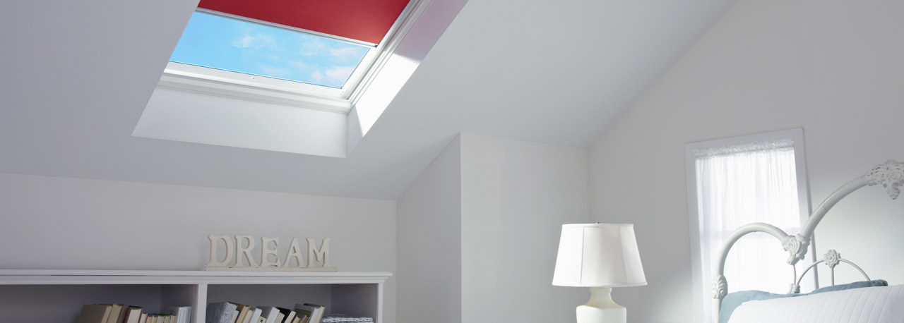 skylights with red blinds for the bedroom