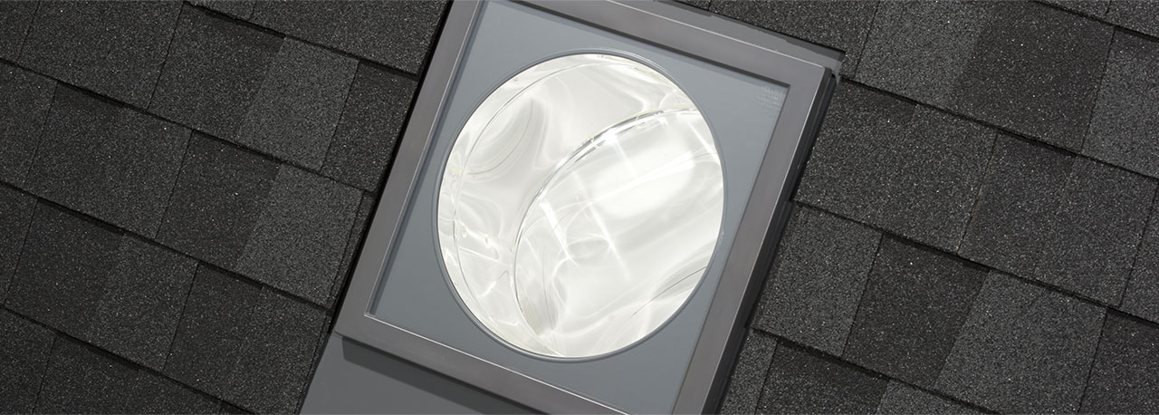 Velux sun tunnel rigid skylights pitched low profile for Sun tunnel light