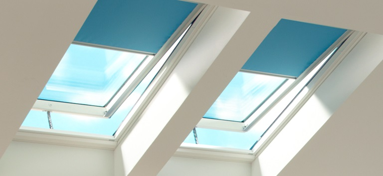 Venting skylights with blue blinds